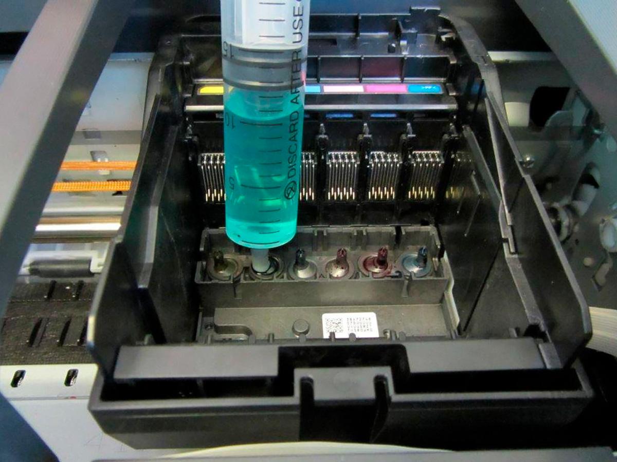 Прочистка головки принтера